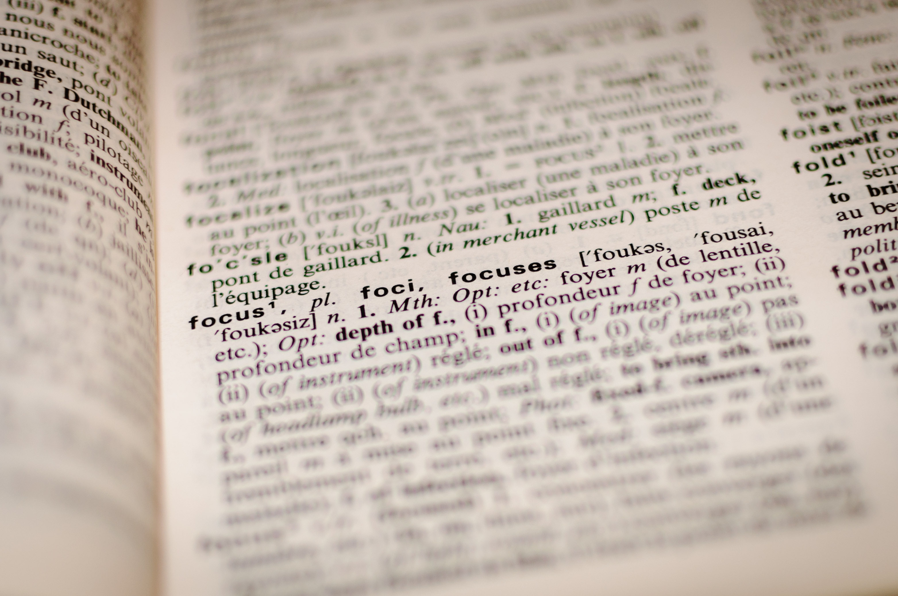 Close up of the definition of the word focus in a dictionary